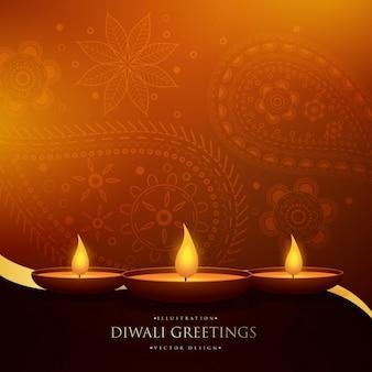 Diwali cumprimento bonito feliz com três diya e decoração de paisley