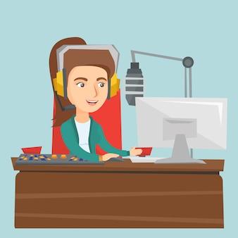 Dj caucasiano fêmea novo que trabalha no rádio.