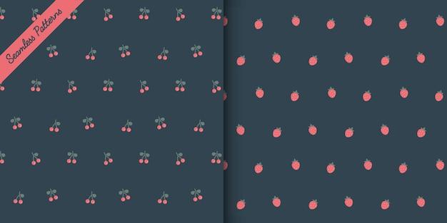 Dois adoráveis morangos e cerejas em padrões sem emenda de fundo escuro definido vetor premium