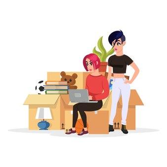 Dois alunos estão perto de uma pilha de coisas em caixas de papelão