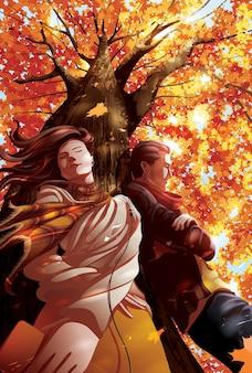 Dois amantes ouvem música juntos sob a árvore no outono