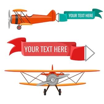Dois biplanos com fitas de publicidade meio de transporte aéreo com texto verde e vermelho anexado
