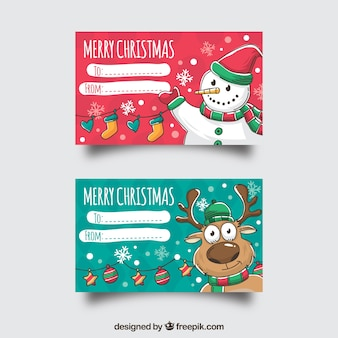 Dois cartões de natal feliz com um boneco de neve e uma rena