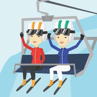 Dois esquiadores felizes usando o teleférico na estância de esqui.