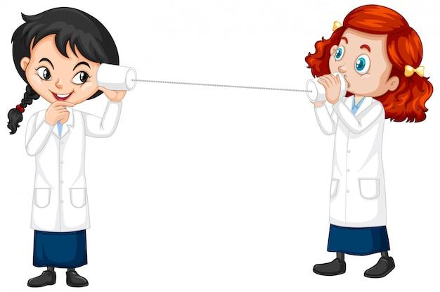 Dois estudantes de ciências experimentando onda sonora