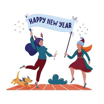 Dois felizes, sorridentes mulheres bonitas, meninas em chifres de chapéu e rena de natal segurando o cartaz com o texto de saudação de feliz ano novo