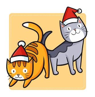 Dois gatos bonitos e engraçados do kawaii usando chapéu de papai noel no natal