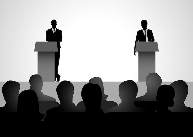 Dois homens figuram debatendo no pódio
