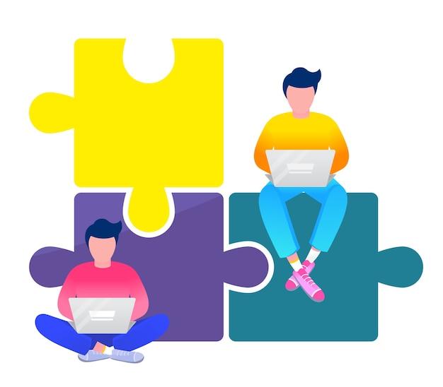 Dois homens sentados em um grande quebra-cabeça metafórico, trabalhando em laptops, cooperação em equipe