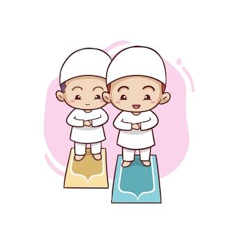 Dois lindos rapazes muçulmanos rezam