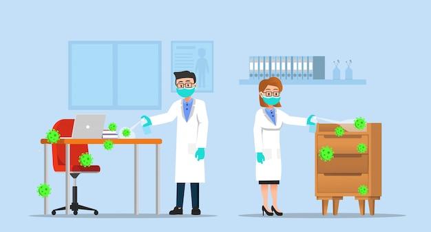 Dois médicos pulverizando a sala com desinfetante