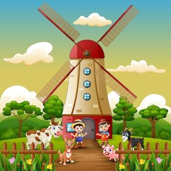 Dois, menino, é, trabalhando, novamente, frente, moinho de vento, predios, fundo