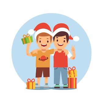 Dois meninos dos desenhos animados comemoram o natal e ano novo