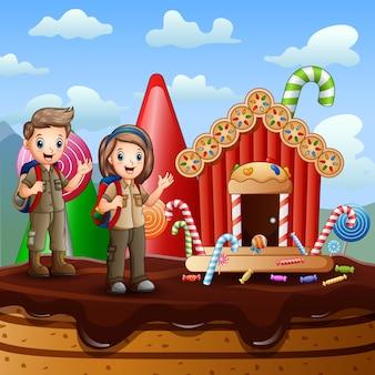 Dois olheiros em uma ilustração de fantasia de doce casa Vetor Premium