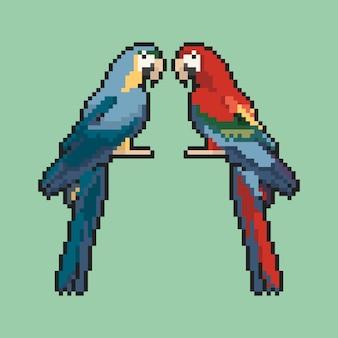 Dois papagaios em uma arte de pixel de fundo verde