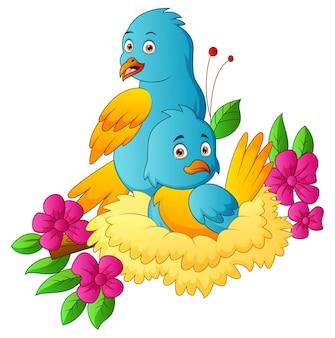 Dois papagaios no filhote com flores