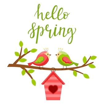 Dois pombinhos em um galho com folhas. uma casa de passarinho com coração. letras de olá primavera.