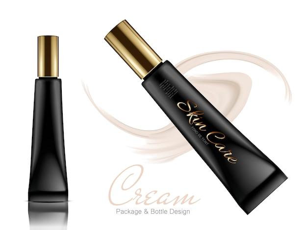 Dois tubos de plástico longos pretos com tampas douradas e elementos creme bege
