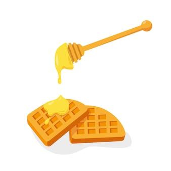 Dois waffles com mel isolado no fundo branco.