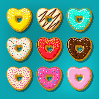 Donuts doces diferentes. conjunto bonito e brilhante de donuts em forma de coração.