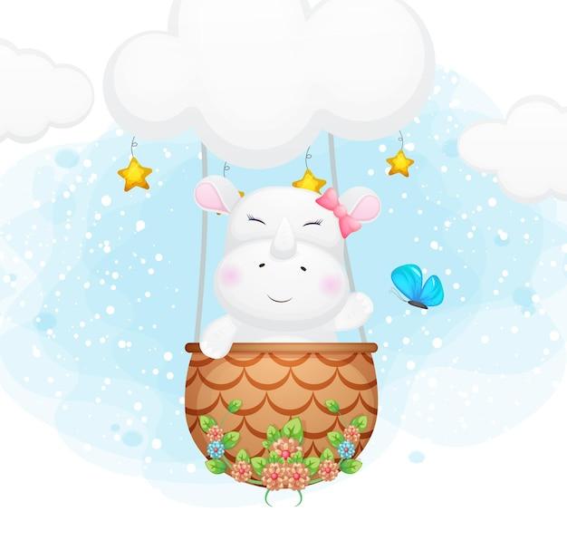 Doodle fofo pequeno rinoceronte voando com uma borboleta no céu Vetor Premium