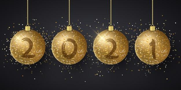 Dourado brilhante pendurado bolas de natal com números de ano novo. pincel de grunge.
