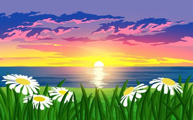 Dramática paisagem por do sol sobre o mar com flores