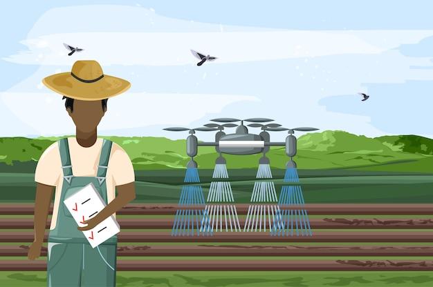 Drone molhando o campo e homem controlando o trabalho