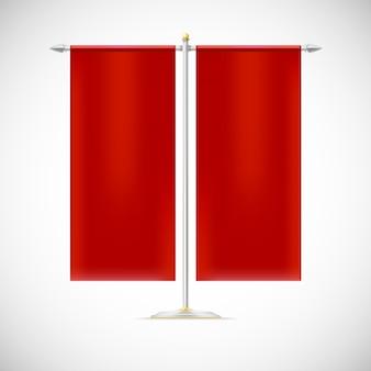 Duas bandeiras vermelhas em suporte
