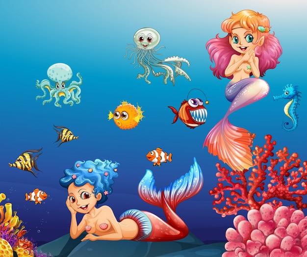 Duas belas sereias e animais marinhos subaquática