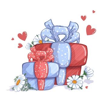 Duas caixas de presente, decoradas com laços, flores de camomila branca e corações vermelhos.