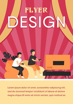 Duas crianças adolescentes felizes e animadas sentadas no sofá na frente da tv com gamepads e jogando videogame