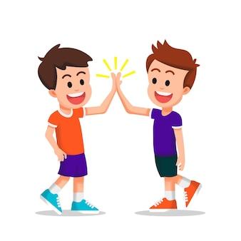 Duas crianças felizes fazem um high five juntos