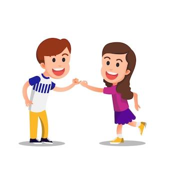 Duas crianças fofas com seus gestos de dedo mínimo ligados como um sinal de promessa