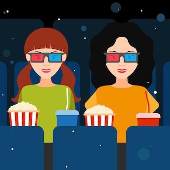 Duas garotas no cinema em óculos 3d.