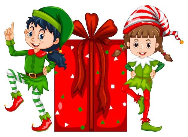 Duas garotas vestidas em traje de elfo e caixa de presente vermelha