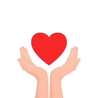 Duas mãos com coração vermelho