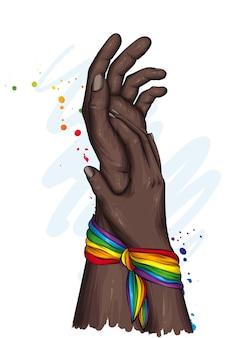 Duas mãos e uma fita de arco-íris
