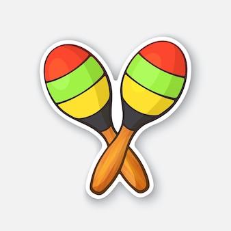 Duas maracas de madeira cruzadas em listras coloridas.