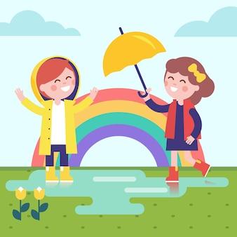 Duas meninas brincando na chuva e no arco-íris