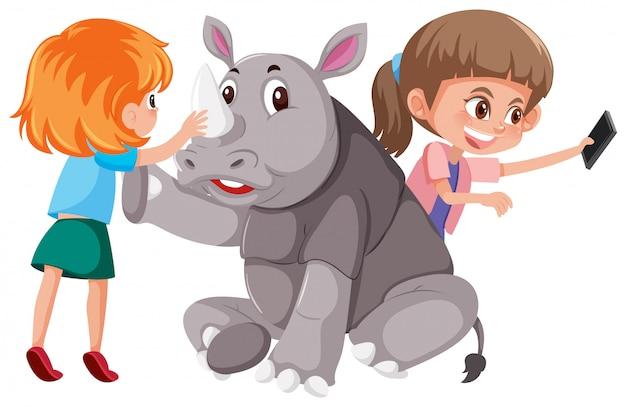 Duas meninas, com, cute, rinoceronte