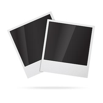 Duas molduras para fotos instantâneas em branco.