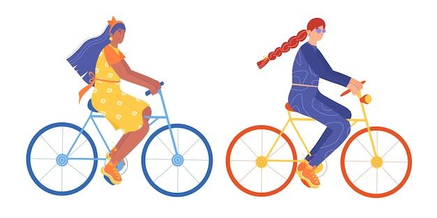Duas mulheres andam de bicicleta. isolado no fundo branco.