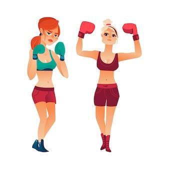 Duas mulheres bonitas boxer, meninas em luvas de boxe