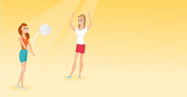 Duas mulheres caucasianas jogando vôlei de praia