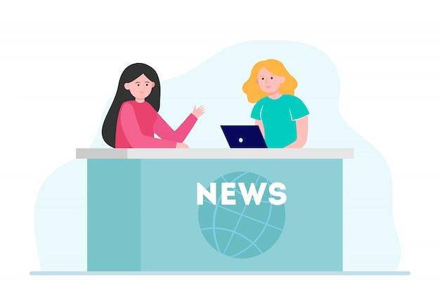 Duas mulheres contando novidades no estúdio