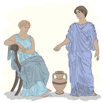 Duas mulheres da grécia antiga com túnicas conversam perto de uma jarra de vinho.