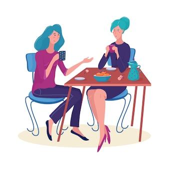 Duas mulheres, meninas sentadas à mesa