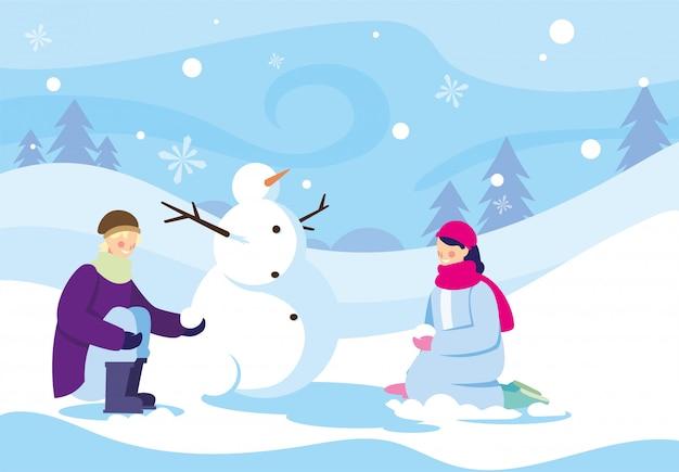 Duas pessoas com boneco de neve na paisagem de inverno