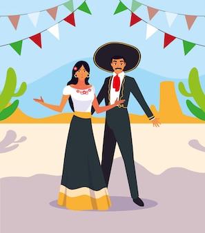 Duas pessoas com fantasias mariachi